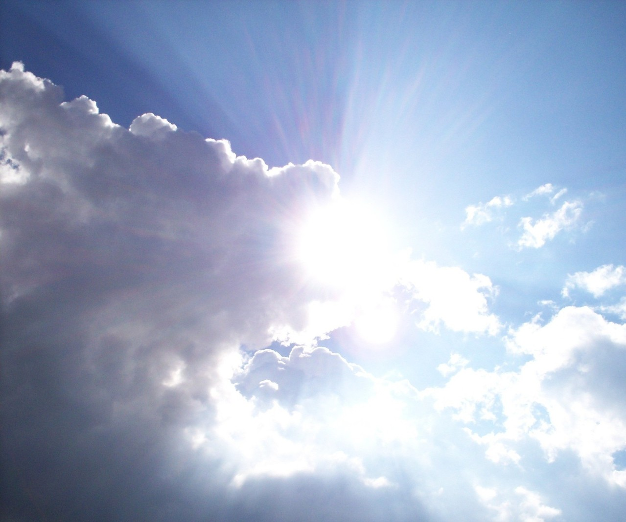 Sunlight Behind the Clouds in a Blue Sky